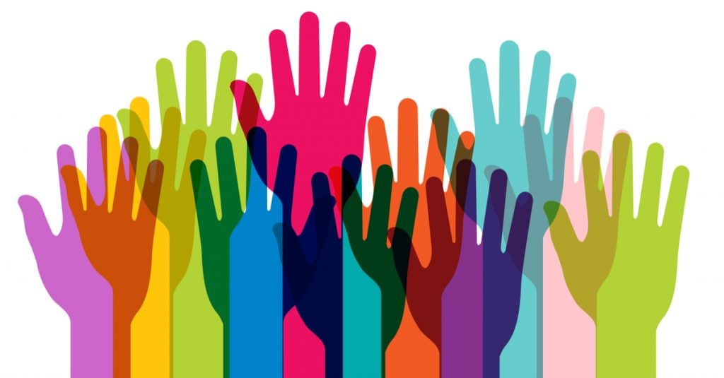 Picture of raised hands in different colors