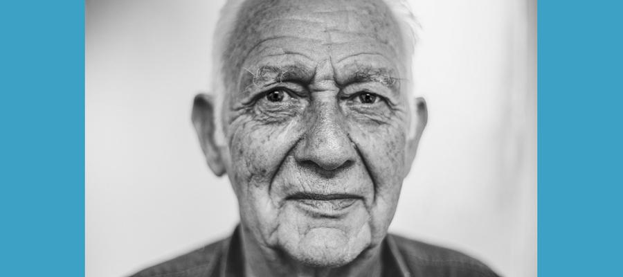 Older man looking at the camera.